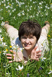 Woman lying in green grass Stock Photography
