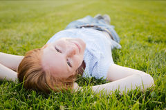Woman Lying on Green Grass Royalty Free Stock Photography