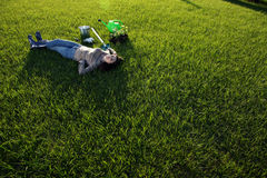 Woman lying on green grass Stock Image