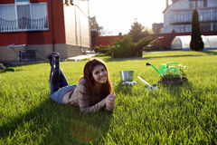 Woman lying on green grass Royalty Free Stock Image