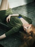 Woman lying on ground. Portrait of young woman lying on ground Stock Images