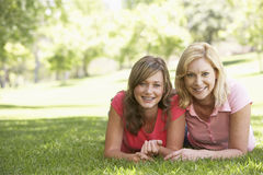 Woman Lying On The Ground With Teenage Daughter Royalty Free Stock Image
