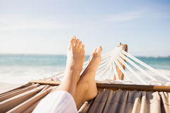 Woman lying in hammock. On the beach Stock Images