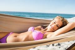 Woman lying in hammock Stock Image