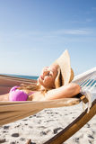 Woman lying in hammock. On the beach Stock Photography