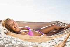 Woman lying in hammock. On the beach Royalty Free Stock Photography