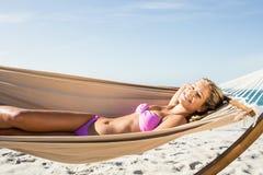 Woman lying in hammock Stock Photo