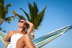 Woman lying in a hammock on a beach Royalty Free Stock Images