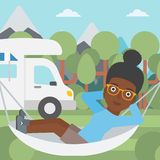 Woman lying in hammock in front of motor home. Stock Photography