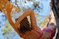 Woman lying in hammock on seacoast Royalty Free Stock Photos