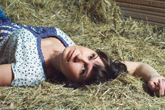 Woman lying on hay Stock Photos