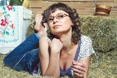 Woman lying on hay Royalty Free Stock Image