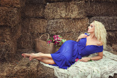 Woman lying on hay in the village. Stock Photos