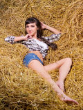 Woman lying on haystack Royalty Free Stock Images
