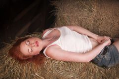 Woman lying on a haystack Royalty Free Stock Image