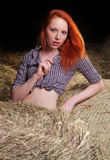 Woman lying on a haystack Royalty Free Stock Photography