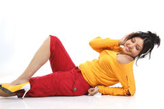Woman  lying with headphones Royalty Free Stock Photography