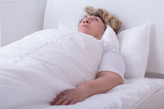 Woman lying on her back. Ill woman lying on her back in hospital bed Stock Photos