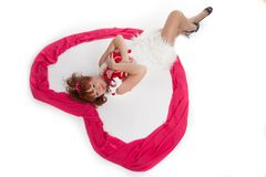 Woman on his back. Woman lying on her back on white Stock Photography