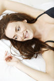 Woman lying on her bed Royalty Free Stock Photo