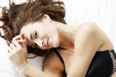 Woman lying on her bed Stock Photo