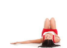 Woman lying with her legs raised straight up Royalty Free Stock Photography