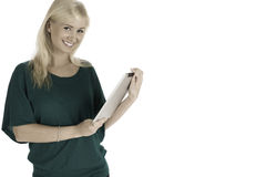 Woman standing holding tablet. Smiling relaxed female standing and holding-using a tablet stock photography