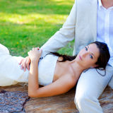 Woman lying on husband leg in a park trunk Stock Photo