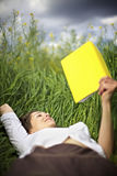 Woman Lying In Rapeseed Field Reading Stock Photos