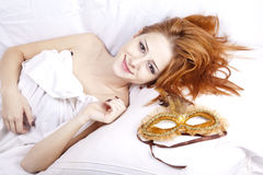 Woman Lying In The Bed Near Carnival Mask. Royalty Free Stock Photos