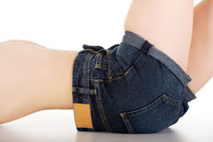 Woman lying in jeans shorts. Royalty Free Stock Photo