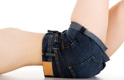 Woman lying in jeans shorts. Stock Photos
