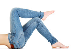 Woman lying in jeans. Royalty Free Stock Photos
