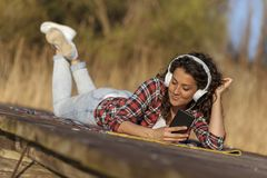 Woman listening to the music royalty free stock photos