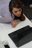 Woman lying with laptop Royalty Free Stock Photography