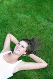 Woman lying on a lawn Royalty Free Stock Images