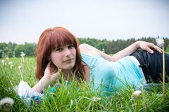 Woman lying on a lawn Stock Images