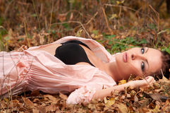 Woman lying on the leaves Royalty Free Stock Images