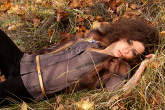 Woman lying on the leaves Stock Image