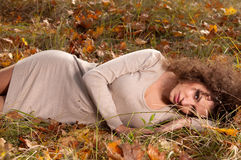 Woman lying on the leaves Royalty Free Stock Photography