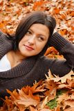 Woman lying on leaves Royalty Free Stock Image