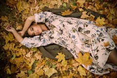 Woman lying on leaves stock images