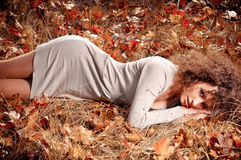 Woman lying on the leaves Royalty Free Stock Photo