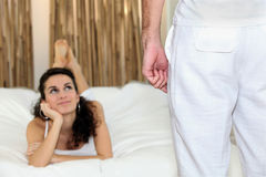 Woman lying looking up at a man Stock Photos