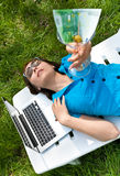 Woman lying on the lounge and holding a wineglass Royalty Free Stock Images
