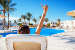 Woman lying on a lounger by the pool at the hotel Stock Photography
