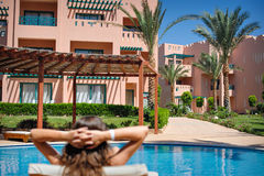 Woman lying on a lounger by the pool at the hotel Royalty Free Stock Photo
