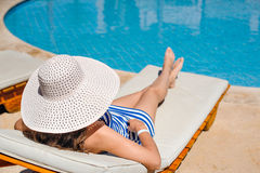 Woman lying on a lounger by the pool at the hotel Royalty Free Stock Images
