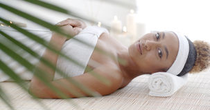 Woman Lying On A Lounger In Wellness Center Royalty Free Stock Images