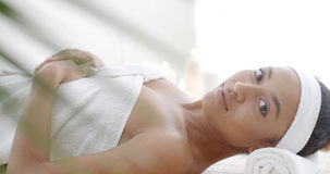 Woman Lying On A Lounger In Wellness Center Royalty Free Stock Photos